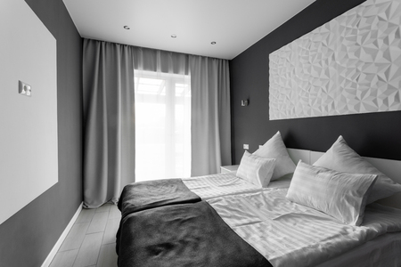 daylight morning. Hotel standart room. modern bedroom with white pillows. simple and stylish interior.