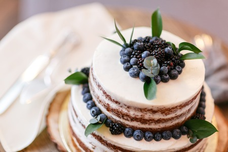 Wedding or birthday cake with berries. Sweet pie on banquet in restaurant.