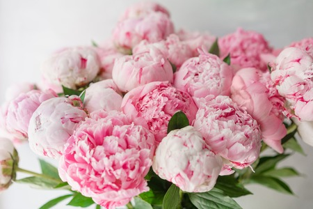 Beautiful bouquet of pink peonies . Floral composition, daylight. Wallpaper. Lovely flowers in glass vase.