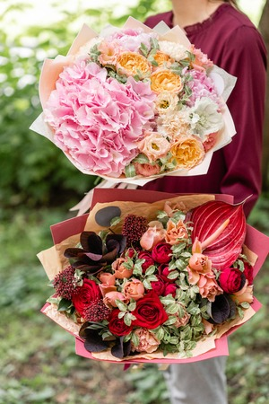 Two beautiful summer bouquet arrangement with mix flowers young 104974402 two beautiful summer bouquet arrangement with mix flowers young girl holding red and pink flower arrgver6 mightylinksfo