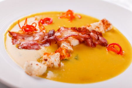 Traditional Spanish cold soup, with bread sticks and bacon chips. Corn Spanishwith bacon. chowder