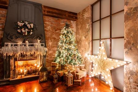Winter home decor. Christmas in loft interior against brick wall. gifts under the tree Reklamní fotografie