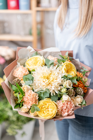 European floral shop. Bouquet of beautiful Mixed flowers in woman hand. Excellent garden flowers in the arrangement , the work of a professional florist. 版權商用圖片