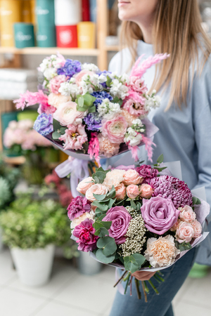 European floral shop. Two Bouquet of beautiful Mixed flowers in woman hand. Excellent garden flowers in the arrangement , the work of a professional florist. 版權商用圖片