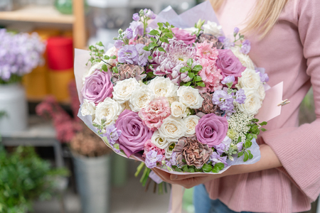 European floral shop. Bouquet of beautiful Mixed flowers in woman hand. Excellent garden flowers in the arrangement , the work of a professional florist. Stock fotó
