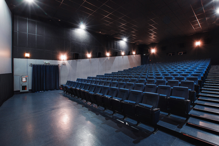 Russia, Nizhny Novgorod - may 26, 2014: Sormovsky Cinema. Empty blue cinema hall seats, comfortable and soft chairs. Perspective auditorium view Éditoriale