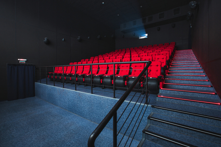 Russia, Nizhny Novgorod - may 26, 2014: Sormovsky Cinema. Empty red cinema hall seats, comfortable and soft chairs. Perspective auditorium view Éditoriale