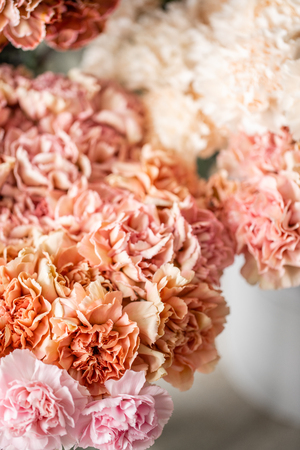 carnation flowers of different varieties and colors. Bunch pastel color. the concept of a florist in a flower shop. Wallpaper.