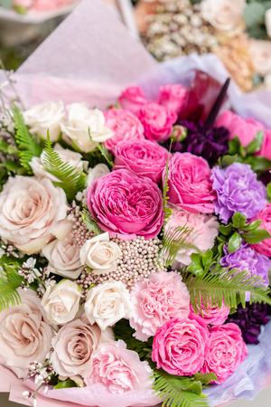 ombre of color. beautiful fresh cut bouquet of mixed flowers. the work of the florist at a flower shop. Delicate Pastel tones color