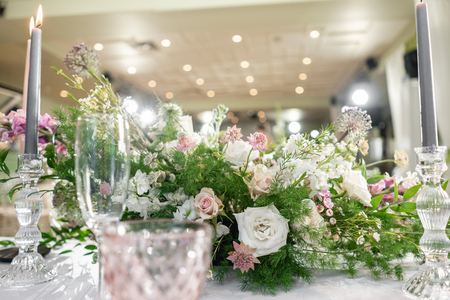 Floral decoration for wedding ceremony romance dining. Wedding banquet , festive decor. Bouquet from spring and summer flowers. Table layout. Restaurant interior. Concept of service and catering.