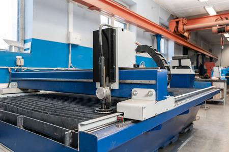 Industrial plasma machine cut of metal plate. New CNC Laser Plasma. Selective focus on laser plasma cutting of metal modern technology.