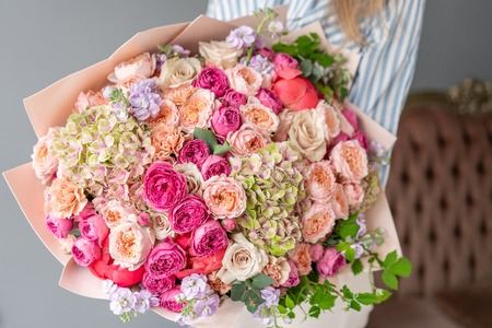 Large Beautiful bouquet of mixed flowers in woman hand. Floral shop concept . Beautiful fresh cut bouquet. Flowers delivery Reklamní fotografie - 122713515