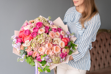 Large Beautiful bouquet of mixed flowers in woman hand. Floral shop concept . Beautiful fresh cut bouquet. Flowers delivery Reklamní fotografie - 122713516