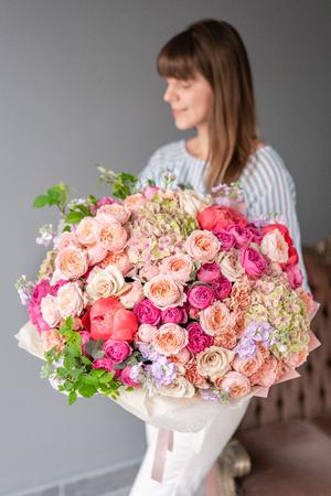 Large Beautiful bouquet of mixed flowers in woman hand. Floral shop concept . Beautiful fresh cut bouquet. Flowers delivery Reklamní fotografie - 122713517