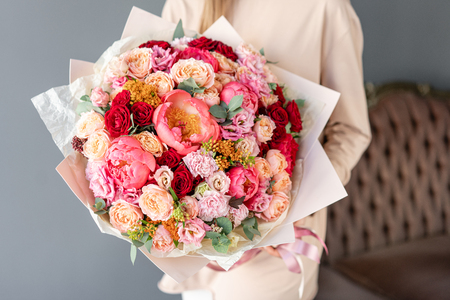Large Beautiful bouquet of mixed flowers in woman hand. Floral shop concept . Beautiful fresh cut bouquet. Flowers delivery