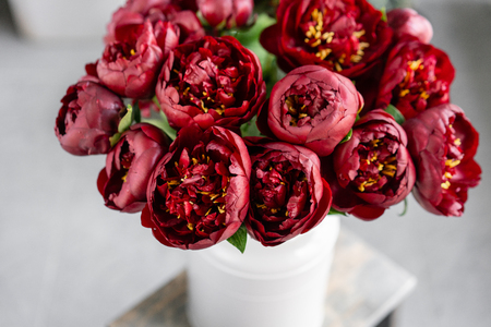 Red peonies in a metal vase. Beautiful peony flower for catalog or online store. Floral shop concept . Beautiful fresh cut bouquet. Flowers delivery 版權商用圖片