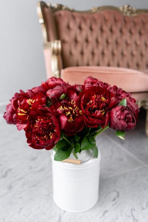 Red peonies in a metal vase. Beautiful peony flower for catalog or online store. Floral shop concept . Beautiful fresh cut bouquet. Flowers delivery Stock Photo