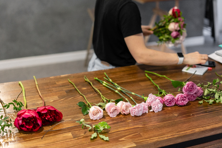 set of flowers for a bouquet on the table. The job of a florist. Master class on making bouquets. Summer bouquet. Flowers delivery