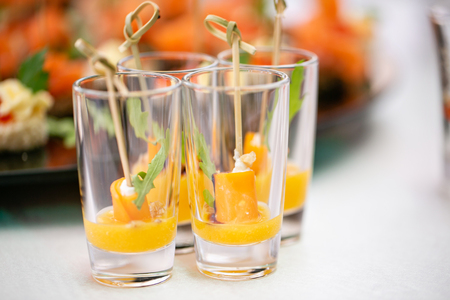 Mango with honey. Buffet at the gala dinner. Assortment of canapes. Banquet service.