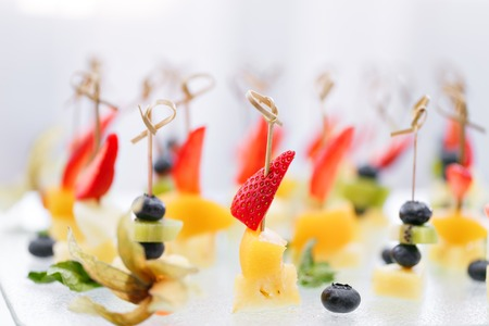 Buffet at the gala dinner. Canapes with cheese, pineapple and strawberries. Assortment of canapes. Banquet service. catering food