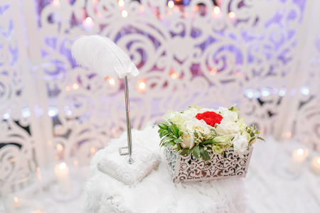 Wedding ceremony. Two golden wedding rings laying on tray of roses. accessories for the bride and groom. Preparation for the ceremony