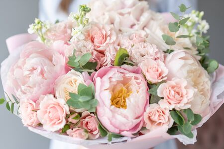 Two Small Beautiful bouquets of mixed flowers in woman hand. Floral shop concept . Beautiful fresh cut bouquet. Flowers delivery