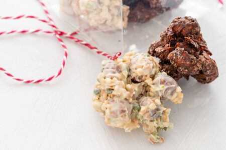 Rocks with chocolate and nuts. Christmas theme. Healthy sweet dessert snack. Granola bar with nuts, fruit, chocolate and berries.