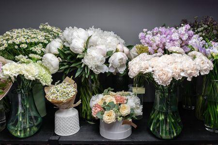 showcase flower shop. Beautiful spring bouquets. Arrangement with mix flowers. Small family business. Work florist. copy space.
