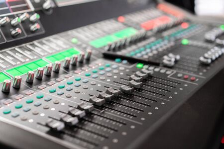 control Fader. Mixing console of light equipment operator at the concert. Sound recording studio mixing desk with engineer or music producer