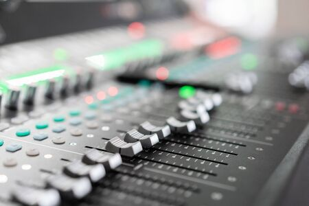 Music mixer equalizer console for mixer control sound device. Sound technician audio mixer equalizer control. Mastering For Radio and TV Broadcast.