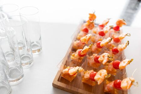 Delicious shrimp and sliced tomatoes. Tasty buffet table. Catering concept