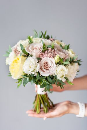 Bridal bouquet with white. Beautiful bouquet of mixed flowers in woman hand. Floral shop concept . Handsome fresh bouquet. Flowers delivery