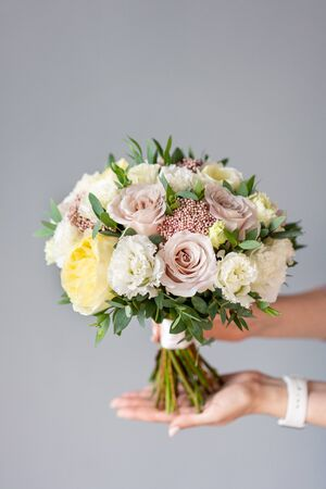 Bridal bouquet. Beautiful bouquet of mixed flowers in woman hand. Floral shop concept . Handsome fresh bouquet. Flowers delivery Imagens