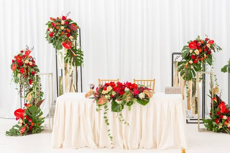 Red decor theme. Beautiful banquet a wedding reception. Interior of a wedding tent decoration ready for guests. Decor flowers. Stock fotó