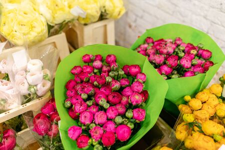 Warehouse refrigerator, Wholesale flowers for flower shops. Persian Buttercup, Ranunculusin a plastic container or bucket. Online store. Floral shop and delivery concept. Banco de Imagens