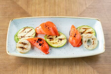 Grilled vegetables. Various side dishes in the restaurant menu