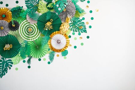 Green, emerald, gold and yellow papers circle shape of origami. Abstract background of paper designs. Copy space.