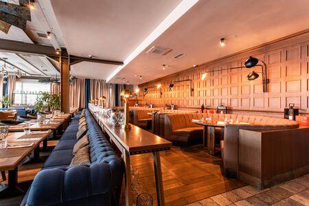 Nizhny Novgorod, Russia - November 09 2018. GAUCHOBARBQ and GRILL. Restaurant interior. Steak house, barbecue and grill. Restaurant of Argentine cuisine. modern european restaurant Editorial