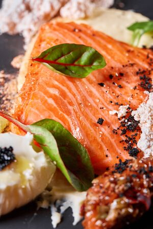 Closeup Salmon steak fillet with eggs and vegetables. Restaurant menu, a series of photos of different dishes Standard-Bild