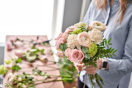 Education in the school of floristry. Master class on making bouquets. Summer bouquet. Learning flower arranging, making beautiful bouquets with your own hands. Flowers delivery.