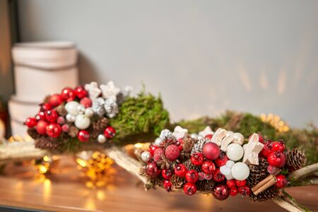 Closeup Christmas arrangement. Master class on making decorative ornaments. Christmas decor with their own hands. The new year celebration. Flower shop