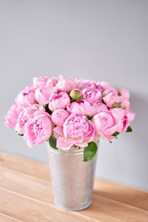 Pink Angel Cheeks peonies in a metal vase. Beautiful peony flower for catalog or online store. Floral shop concept . Beautiful fresh cut bouquet. Flowers delivery