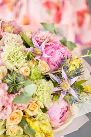 Beautiful bouquet of mixed flowers in woman hand. Floral shop concept . Handsome fresh bouquet. Flowers delivery. Standard-Bild - 150495560