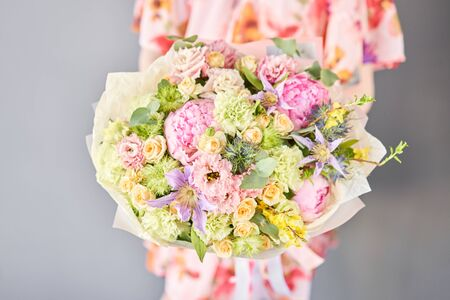 Beautiful bouquet of mixed flowers in woman hand. Floral shop concept . Handsome fresh bouquet. Flowers delivery. Standard-Bild - 150495670