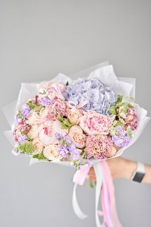 Beautiful bouquet of mixed flowers in woman hand. Floral shop concept . Handsome fresh bouquet. Flowers delivery. Standard-Bild - 150495488