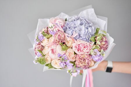 Beautiful bouquet of mixed flowers in woman hand. Floral shop concept . Handsome fresh bouquet. Flowers delivery. Standard-Bild - 150495603