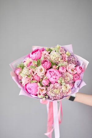 Beautiful bouquet of mixed flowers in woman hand. Floral shop concept . Handsome fresh bouquet. Flowers delivery. Standard-Bild - 150495507