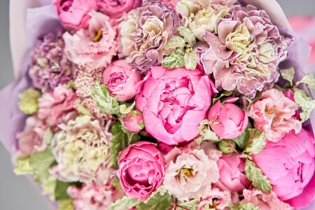 Beautiful bouquet of mixed flowers in woman hand. Floral shop concept . Handsome fresh bouquet. Flowers delivery. Standard-Bild - 150497037