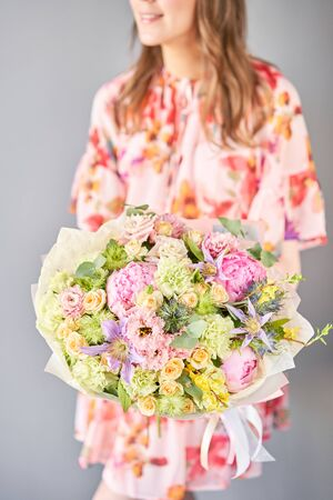 Beautiful bouquet of mixed flowers in woman hand. Floral shop concept . Handsome fresh bouquet. Flowers delivery. Standard-Bild - 150496506