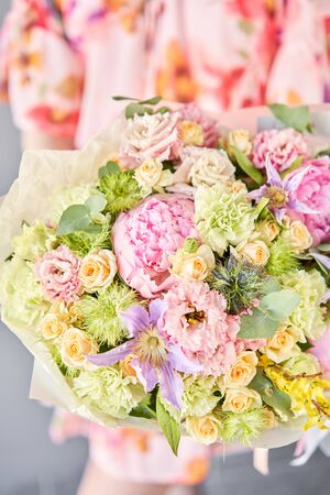 Beautiful bouquet of mixed flowers in woman hand. Floral shop concept . Handsome fresh bouquet. Flowers delivery. Standard-Bild - 150497040